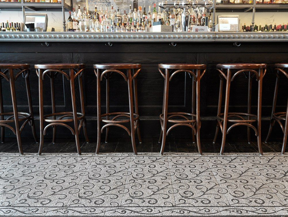 The Curve pattern from the Lace collection adds a Parisienne feel to the floor of this bistro.