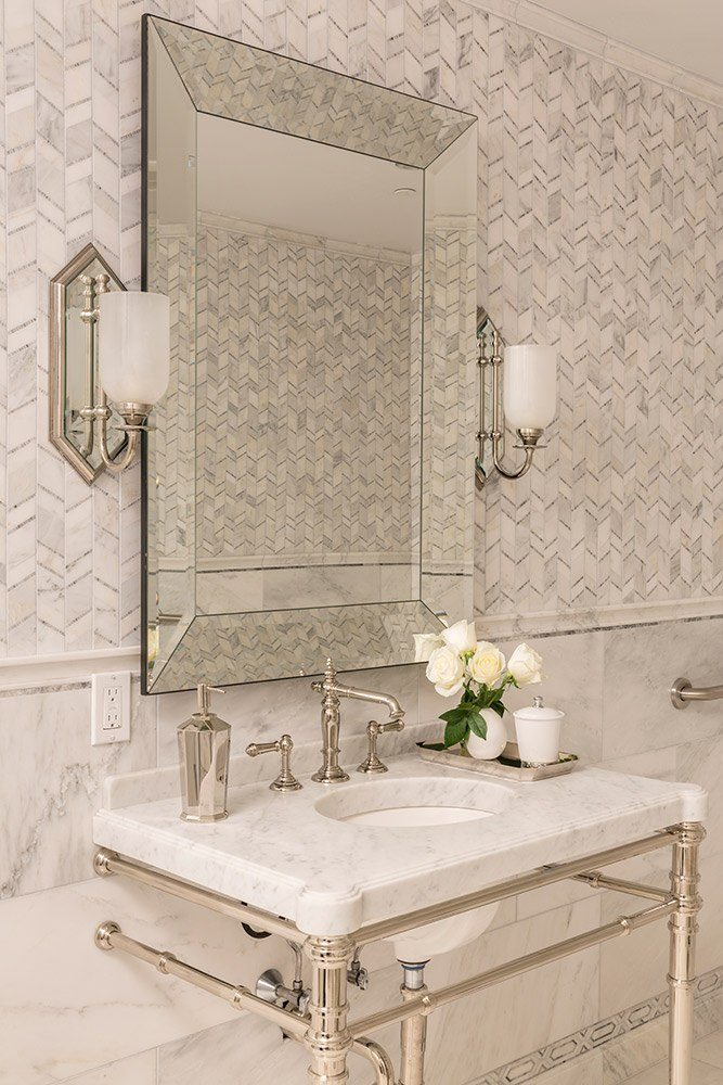Allure is used on an upper wall and as a decorative border above the baseboard in this classic bath.